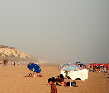 visithuelva playa de rompeculos